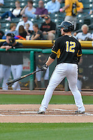 Todd Cunningham (12) of the Salt Lake Bees at bat against the Albuquerque Isotopes in Pacific Coast League action at Smith's Ballpark on August 30, 2016 in Salt Lake City, Utah. The Bees defeated the Isotopes 3-2. (Stephen Smith/Four Seam Images)