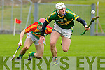 Kerry's Shane Nolan controls the loose ball as he goes past Cillian McCabe Carlow during their NHL game in Tralee on Sunday