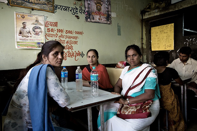 Hajra, Mumtaz and Sheinaz sit in a cafe whilst taking a break from field work in a red light district in Solupur, South Mahrashtra. The three women work as peer educators with SAI, an NGO based in Mumbai.