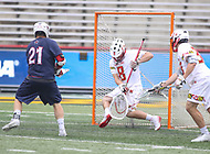 College Park, MD - May 13, 2018: Maryland Terrapins Dan Morris (8) tries to stop the goal by Robert Morris Colonials Adrian Torok-Orban (21) during the NCAA first round game between Robert Morris and Maryland at  Capital One Field at Maryland Stadium in College Park, MD.  (Photo by Elliott Brown/Media Images International)