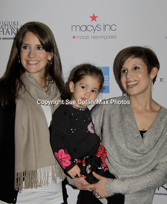 Nicole & Alana Feld - holding Piper Straus - Skating with the Stars - a benefit gala for Figure Skating in Harlem in its 17th year is celebrated with many US, World and Olympic Skaters honoring Michelle Kwan and Jeff Treedy on April 7, 2014 at Trump Rink, Central Park, New York City, New York. (Photo by Sue Coflin/Max Photos)