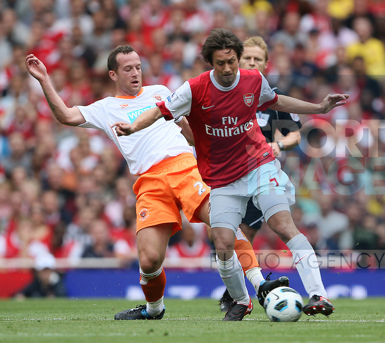 Arsenal's Tomas Rosicky tussles with Blackpool's Charlie Adam