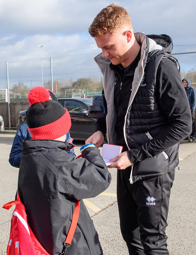 Lincoln City's James Brown signs autographs for fans outside the ground<br /> <br /> Photographer Chris Vaughan/CameraSport<br /> <br /> The EFL Sky Bet League Two - Lincoln City v Northampton Town - Saturday 9th February 2019 - Sincil Bank - Lincoln<br /> <br /> World Copyright © 2019 CameraSport. All rights reserved. 43 Linden Ave. Countesthorpe. Leicester. England. LE8 5PG - Tel: +44 (0) 116 277 4147 - admin@camerasport.com - www.camerasport.com