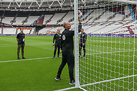 Referee Mike Dean tests the goal line technology ahead of the Premier League match between West Ham United and Manchester City at the London Stadium, London, England on 10 August 2019. Photo by David Horn.