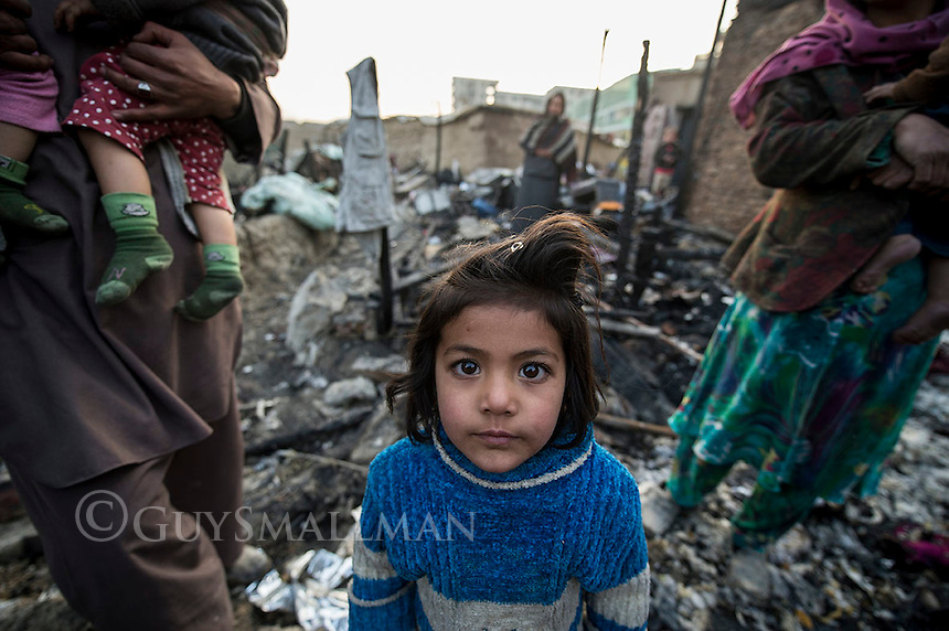 Aftermath of fire at Chamne Babrak refugee camp. 1-1-14 Nine families lost their homes and possessions when a fire caused by a gas bottle explosion spread through part of the camp.