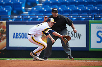 Michigan Wolverines first baseman Carmen Benedetti (43) fields a ground ball in front of umpire Kyle Reese during the first game of a doubleheader against the Canisius College Golden Griffins on June 20, 2016 at Tradition Field in St. Lucie, Florida.  Michigan defeated Canisius 6-2.  (Mike Janes/Four Seam Images)