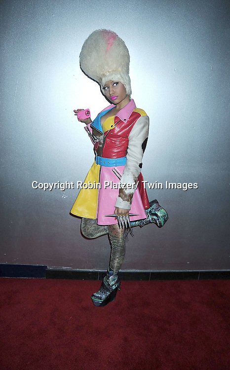 Nicki Minaj holding a Casio Tryx Camera at  The Casio Tryx Camera Launch .on April 7, 2011 at the Best Buy Theatre in New York City. Nicki Minaj and The Roots performed.