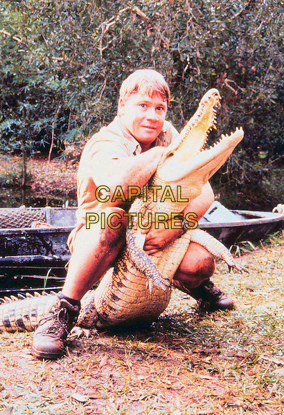 CROCODILE HUNTER .Steve Irwin with crocodile.Filmstill - Editorial Use Only.Ref: FB.sales@capitalpictures.com.www.capitalpictures.com.Supplied by Capital Pictures.