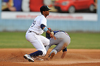 Asheville Tourists shortstop Rosell Herrera #29 fields a throw as Tony Mueller slides in safe during a game against the Rome Braves at McCormick Field on June 23, 2012 in Asheville, North Carolina.  The Braves defeated the Tourists 4-2. (Tony Farlow/Four Seam Images).