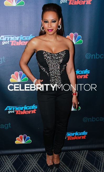 "NEW YORK, NY - SEPTEMBER 11: Mel B (Melanie Brown) arrives at the ""America's Got Talent"" Season 8 Red Carpet Event at Radio City Music Hall on September 11, 2013 in New York City. (Photo by Jeffery Duran/Celebrity Monitor)"