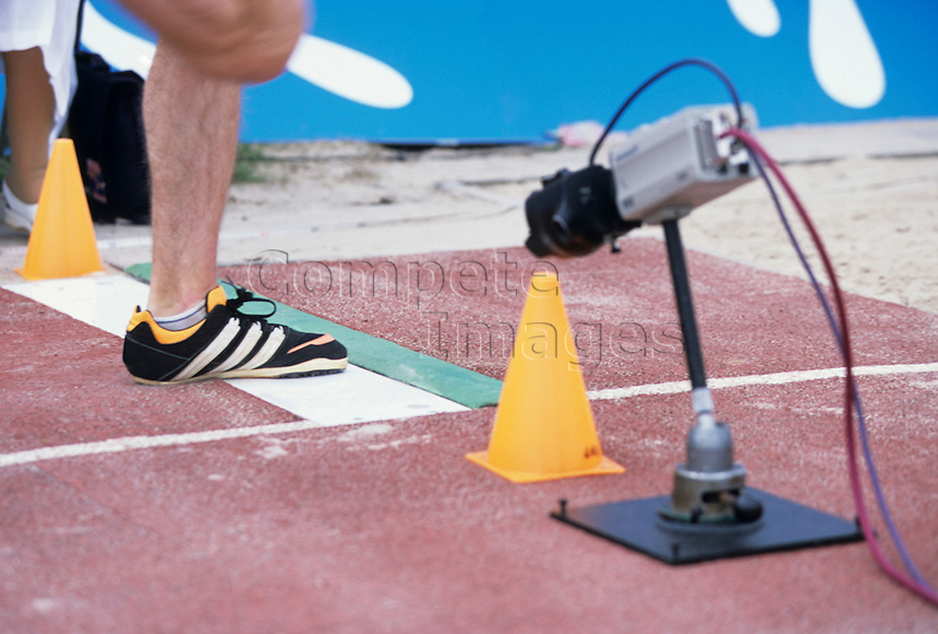 Camera pointing at a long jump launch board