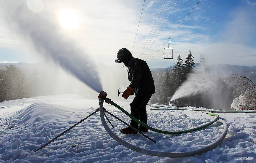 "Doug Fichera, 21, prepares to chip ice off of a snow maker spray nozzle as it produces fresh snow up on a peak at hi sfamily owned ski resort Black Mountain in Jackson, N.H, Tuesday, Dec. 24, 2013.   Fichera was recently named a ""Top Ten Young Gun"" in an snow making industry poll.  CREDIT: Cheryl Senter for The Boston Globe"