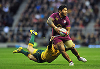 Manu Tuilagi looks to offload the ball after being tackled. QBE International match between England and Australia on November 17, 2012 at Twickenham Stadium in London, England. Photo by: Patrick Khachfe / Onside Images