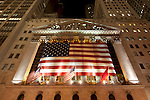Low angle shot of New York's Stock Exchange on Wall Street at night.