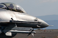 An F-16 Fighting Falcon from the California Air National Guard's 144th Fighter Wing sits on the ramp at Nevada's Stead Field. The 144th Fighter Wing is based out of Fresno, California, and is tasked with providing air defense protection for California from the Mexican border to Oregon. Photographed 9/07.