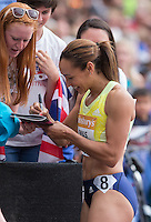 Jessica Ennis-Hill signs an autograph for a spectator during the Sainsbury's Anniversary Games, Athletics event at the Olympic Park, London, England on 25 July 2015. Photo by Andy Rowland.