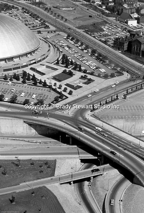 Pittsburgh PA:  An aerial view of the entrance to Pittsburgh's Civic Arena - 1964.  Constructed in 1961, for use by the Pittsburgh Civic Light Opera (CLO), the Civic Arena hosted numerous concerts, the circus, political and religious rallies, roller derbies as well as contests in hockey, basketball, fish tournament weigh-ins, pro tennis (Pittsburgh Triangles of the WTT) in the mid-1970s, boxing, wrestling, lacrosse, football, ice skating championships, kennel shows, and soccer. The structure has been used as the backdrop for several major Hollywood films, most prominently Sudden Death in 1995.