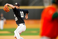 Relief pitcher Michael Dimock #23 of the Wake Forest Demon Deacons in action against the Miami Hurricanes at Gene Hooks Field on March 19, 2011 in Winston-Salem, North Carolina.  The Hurricanes defeated the Demon Deacons 4-3.  Photo by Brian Westerholt / Four Seam Images