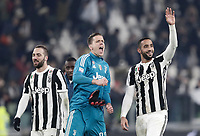 Calcio, Serie A: Juventus - AS Roma, Torino, Allianz Stadium, 23 dicembre, 2017. <br /> Juventus' goalkeeper Wojciech Szczesny (c), Medhi Benatia (r) and Gonzalo Higuain (l) celebrate after winning 1-0 the Italian Serie A football match between Juventus and Roma at Torino's Allianz stadium, December 23, 2017.<br /> UPDATE IMAGES PRESS/Isabella Bonotto