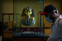 A worker disinfects around King Tut's famous mask in the Egyptian Museum in an effort to help prevent the spread of the coronavirus, in Tahrir Square, Cairo, Egypt, March 23, 2020. (AP Photo/Hamada Elrasam)