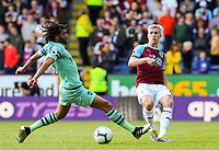 Burnley's Ben Mee plays a ball past Arsenal's Mohamed Elneny<br /> <br /> Photographer Alex Dodd/CameraSport<br /> <br /> The Premier League - Burnley v Arsenal - Sunday 12th May 2019 - Turf Moor - Burnley<br /> <br /> World Copyright &copy; 2019 CameraSport. All rights reserved. 43 Linden Ave. Countesthorpe. Leicester. England. LE8 5PG - Tel: +44 (0) 116 277 4147 - admin@camerasport.com - www.camerasport.com