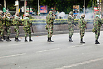 14 MAY 2010 - BANGKOK, THAILAND: Thai troops fire on anti-government protesters on Rama IV Road Friday afternoon. Thai troops and anti government protesters clashed on Rama IV Road Friday afternoon in a series of running battles. Troops fired into the air and at protesters after protesters attacked the troops with rocket and small homemade explosives. Unlike similar confrontations in Bangkok, these protesters were not Red Shirts. Most of the protesters were residents of nearby Khlong Toei slum area, Bangkok's largest slum area. The running battle went on for at least two hours.   PHOTO BY JACK KURTZ
