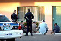 Undocumented Immigrants are detained outside a Coyote Drop house at a local Downtown Phoenix Motel..Photo by AJ Alexander
