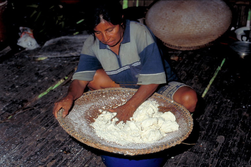 Farmer preparing cassava  to make bread