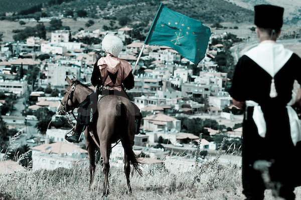 Israeli circassians horse riders marks  the 146th anniversary of the Circassian genocide on May 21, 2010 at the circassian village of Rihaniya.  The Russian-Circassian War (1763 - 1864) refers to a series of battles and wars in Circassia, the northwestern part of the Caucasus, which were part of the Russian Empire's conquest of the Caucasus lasting approximately 150 years, starting under the reign of Tsar Peter the Great and being completed in 1864. Although the conquest of the Caucasus started at least as early as the Russo-Persian War, the term Caucasian War commonly refers only to the period 1817-1864. Those who use the term Russian-Circassian War take its starting date as 1763, when the Russians began establishing forts, including at Mozdok, to be used as springboards for conquest..The Caucasian War ended with the signing of loyalty oaths by Circassian leaders on 2 June 1864 (21 May, O.S.). Afterwards, the Ottoman Empire offered to harbour the Circassians that did not wish to accept the rule of a Christian monarch, and many emigrated to Anatolia, the heart of the Ottoman Empire.  and ended up in modern Turkey, Syria, Lebanon, Israel, Jordan, Iraq and Kosovo). Various Russian, Caucasus, and Western historians agree on the figure of ca. 500,000 inhabitants of the highland Caucasus being deported by Russia in the 1860s. A large fraction of them died in transit from disease. Those that remained loyal to Russia, were settled into the lowlands, the left-bank of the Kuban River. Photo By: Ancho Gosh - JINIPIX