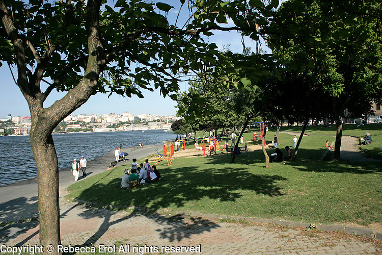 Turkish people relaxing by the Golden Horn, Istanbul, Turkey