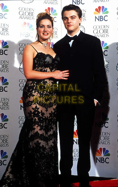 KATE WINSLET & LEONARDO DICAPRIO..Golden Globe Awards..Ref: 043..lace dress, tuxedo, full length, full-length..www.capitalpictures.com..sales@capitalpictures.com..©Capital Pictures