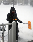 Ginny Christensen, shoveling snow off sidewalk at apartment in Saugerties, NY on Tuesday, March 14, 2017. Photo by Jim Peppler. Copyright Jim Peppler 2017.