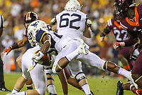 Landover, MD - September 3, 2017: West Virginia Mountaineers running back Justin Crawford (25) gets dives for extra yards during game between Virginia Tech and WVA at  FedEx Field in Landover, MD.  (Photo by Elliott Brown/Media Images International)
