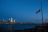 WEEHAWKEN, NJ - APRIL 21:Flags are flying at half-mast as the New York skyline is seen on the background on April 21, 2020 from Weehawken, New Jersey. (Photo by Kena Betancur/ VIEWpress via Getty Images)