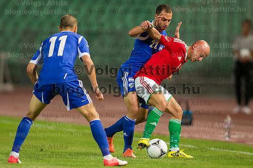 Israel's Eitey Menachem Shechter (L) wathces as Israel's Omer Damari (C) fights for the ball with Hungary's Jozsef Varga (R) Friendly football match Hungary playing against Israel in Budapest, Hungary on August 15, 2012. ATTILA VOLGYI