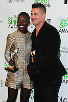 SANTA MONICA, CA, USA - MARCH 01: Lupita Nyong'o, Brad Pitt in the press room during the 2014 Film Independent Spirit Awards held at Santa Monica Beach on March 1, 2014 in Santa Monica, California, United States. (Photo by Xavier Collin/Celebrity Monitor)
