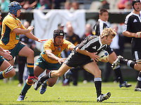 Rhys Llewellyn beats the tackle of Ale Kotoni during the International rugby match between New Zealand Secondary Schools and Suncorp Australia Secondary Schools at Yarrows Stadium, New Plymouth, New Zealand on Friday, 10 October 2008. Photo: Dave Lintott / lintottphoto.co.nz