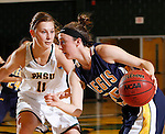 JANUARY 30, 2015 -- Bay'lee Purdy #25 of Regis University drives on Taylor Trohkimoinen #11 of Black Hills State during their Rocky Mountain Athletic Conference women's basketball game Friday evening at the Donald E. Young Center in Spearfish, S.D.  (Photo by Dick Carlson/Inertia)