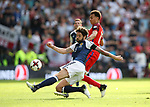 Scotland's Charlie Mulgrew tussles with England's Dele Alli during the FIFA World Cup Qualifying match at Hampden Park Stadium, Glasgow Picture date 10th June 2017. Picture credit should read: David Klein/Sportimage