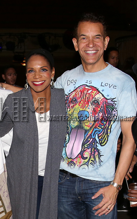 Audra McDonald and Brian Stokes Mitchell during the Actors' Equity Opening Night Gypsy Robe Ceremony honoring Arbender Robinson for 'Shuffle Along' at The Music Box Theatre on April 28, 2016 in New York City.