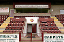 """16/08/2005         Copyright Pic : James Stewart.File Name : sct_jspa05 stenhousemuir.GENERAL VIEW OF OCHILVIEW PARK, THE HOME OF STENHOUSEMUIR FC...... MICHAEL PALIN SAT IN THE STAND JUST ABOVE THE """"SFC"""" LOGO.....Payments to :.James Stewart Photo Agency 19 Carronlea Drive, Falkirk. FK2 8DN      Vat Reg No. 607 6932 25.Office     : +44 (0)1324 570906     .Mobile   : +44 (0)7721 416997.Fax         : +44 (0)1324 570906.E-mail  :  jim@jspa.co.uk.If you require further information then contact Jim Stewart on any of the numbers above........."""