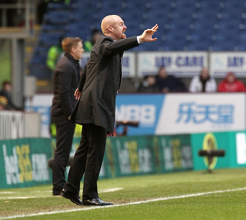 Burnley manager Sean Dyche shouts instructions to his team from the dug-out<br /> <br /> Photographer Rich Linley/CameraSport<br /> <br /> Football - Barclays Premiership - Burnley v Swansea City - Friday 27th February 2015 - Turf Moor - Burnley<br /> <br /> &copy; CameraSport - 43 Linden Ave. Countesthorpe. Leicester. England. LE8 5PG - Tel: +44 (0) 116 277 4147 - admin@camerasport.com - www.camerasport.com