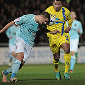 15.01.2013. Torquay, England. Exeter's Scott Bennett defends against Rene Howe during the League Two game between Torquay United and Exeter City from Plainmoor.