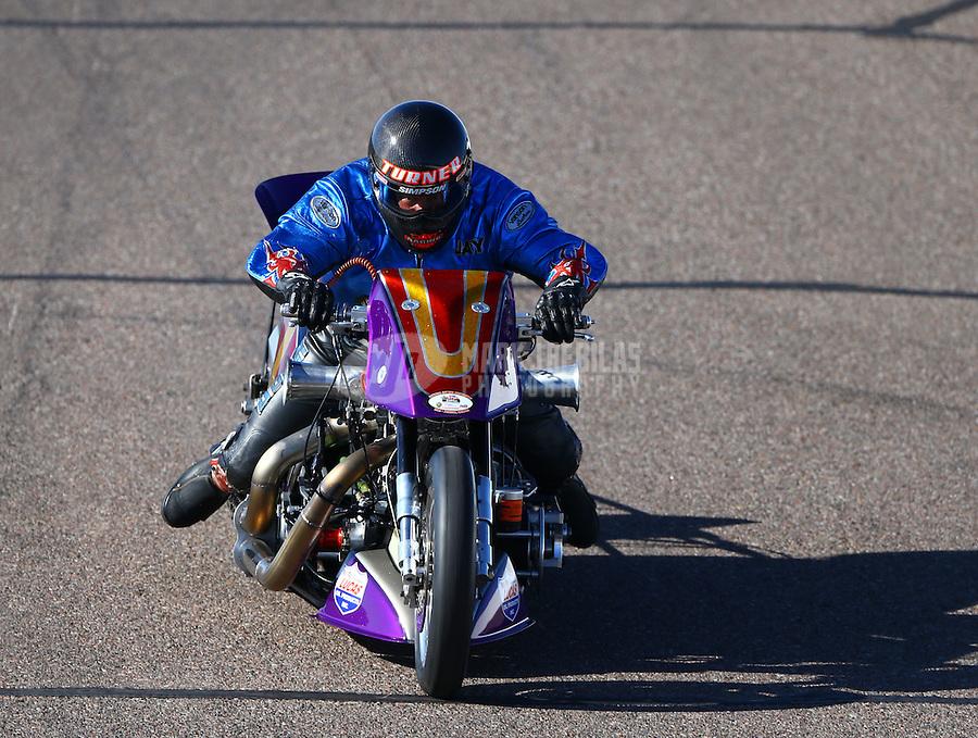 Feb 26, 2016; Chandler, AZ, USA; NHRA top fuel Harley motorcycle rider Jay Turner during qualifying for the Carquest Nationals at Wild Horse Pass Motorsports Park. Mandatory Credit: Mark J. Rebilas-