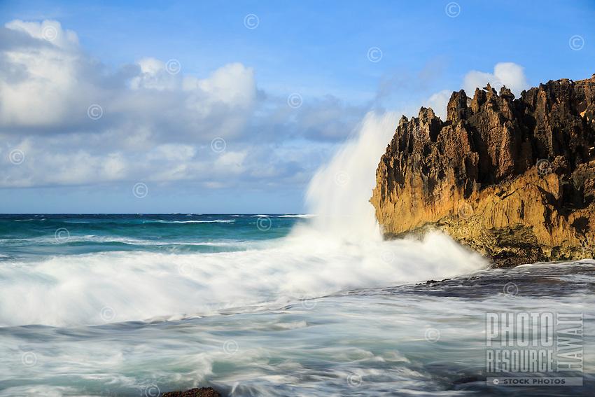 At sunrise, a powerful wave jumps onto the pinnacles (a.k.a. The Pinnacles) along the Maha'ulepu Heritage Trail, southern Kaua'i.