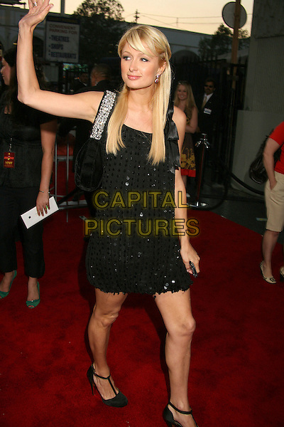"PARIS HILTON.""Rush Hour 3"" Los Angeles Premiere at Grauman's Chinese Theatre, Hollywood, California, USA..July 30th, 2007.full length black  dress t-bar shoes sequins sequined jewel encrusted strap bag purse hand arm waving .CAP/ADM/BP.©Byron Purvis/AdMedia/Capital Pictures"