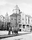 GPHR 45/0041:  Four male students walking in front of Main Building in winter with snow, c1950s..Image from the University of Notre Dame Archives.
