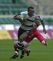 24/05/2002 (Friday).Sport -Rugby Union - London Sevens.Wales vs Fiji.Jone Nareki tackled by Arwel Thomas[Mandatory Credit, Peter Spurier/ Intersport Images].