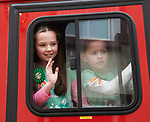 Children wave from inside a fire engine at the St Patrick's Day parade in Killaloe. Photograph by John Kelly.