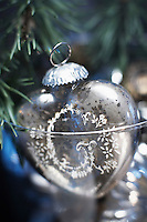 Detail of one of the old fashioned glass ornaments hanging from the Christmas tree